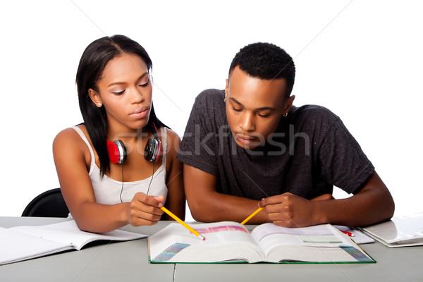 Students helping studying together Stock photo © phakimata