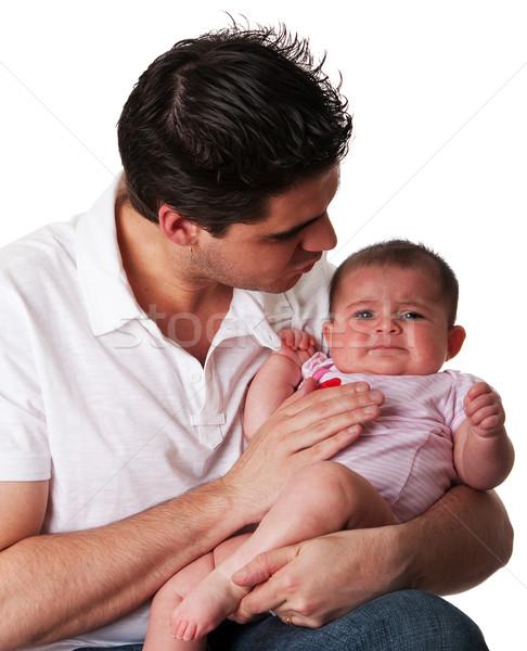 Father calming unhappy baby daughter Stock photo © phakimata