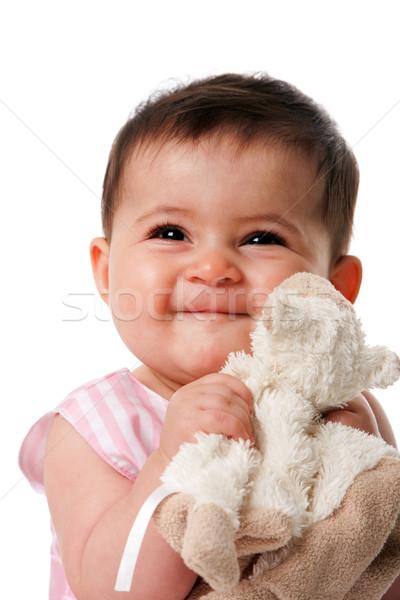 Happy baby with security blanket Stock photo © phakimata