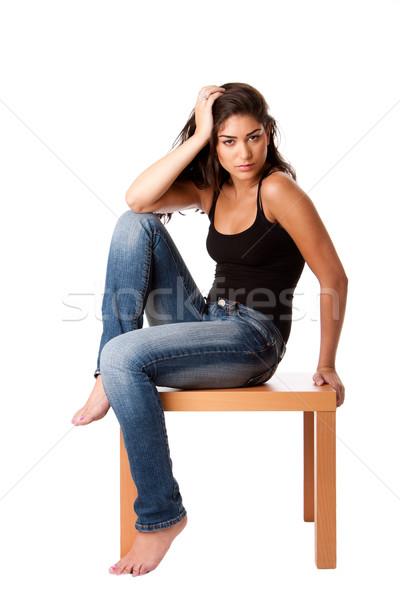 Mode femme jeans séance belle table en bois Photo stock © phakimata