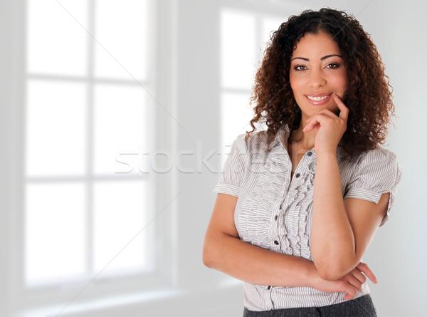 Felice donna d'affari nuovo ufficio bella sorridere Foto d'archivio © phakimata