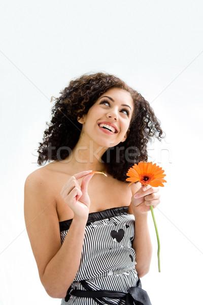 Jeune fille fleur souriant heureux belle jeune femme Photo stock © phakimata