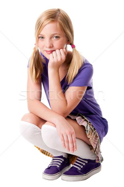 Heureux adolescente belle séance genou Photo stock © phakimata