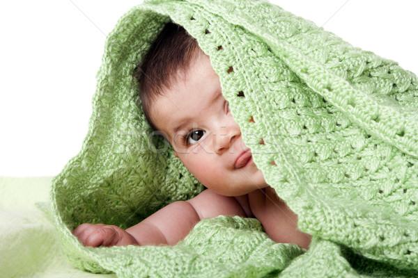 Cute happy baby between green blankets Stock photo © phakimata