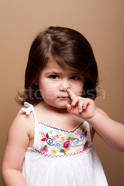 Toddler with finger in nose Stock photo © phakimata