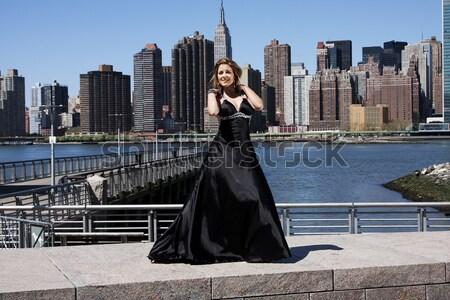 Femme noir robe de cocktail belle heureux Photo stock © phakimata