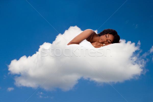 Beautiful woman deeply asleep and dreaming on Cloud nine Stock photo © phakimata