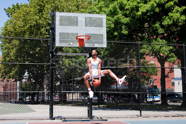 Jumping basketball player Stock photo © phakimata