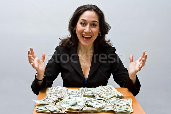 Réussi Finance heureux femme d'affaires séance table Photo stock © phakimata