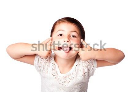 Aranyos vicces arc lány készít hülye izolált Stock fotó © phakimata