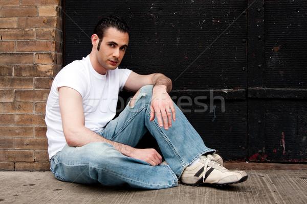 Man sitting on concrete Stock photo © phakimata