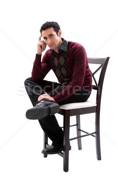 Handsome guy sitting on chair Stock photo © phakimata