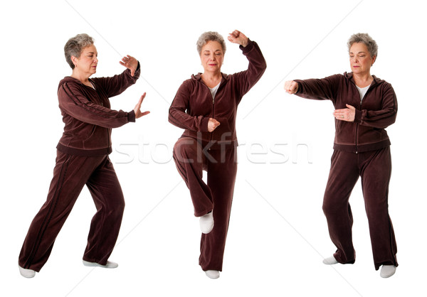 Senior woman doing Tai Chi Yoga exercise Stock photo © phakimata