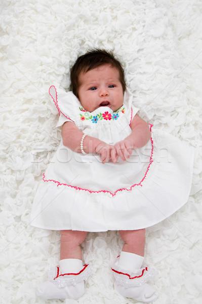 Bébé blanche couverture fleur Photo stock © phakimata