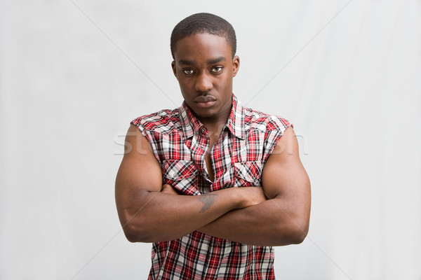Jeunes élégant Guy sombre permanent comme Photo stock © phakimata