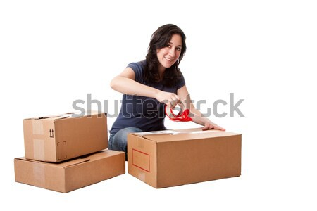 Woman taping moving storage boxes Stock photo © phakimata