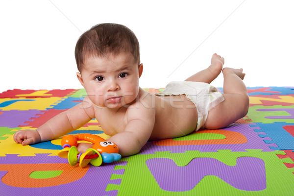 Aranyos baba fektet has gyönyörű boldog Stock fotó © phakimata