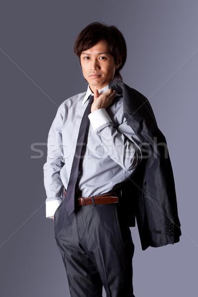 Di successo asian uomo d'affari piedi fiducia giacca Foto d'archivio © phakimata