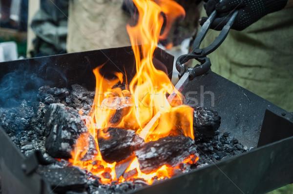 Szczypce metal hot strony ognia Zdjęcia stock © Phantom1311