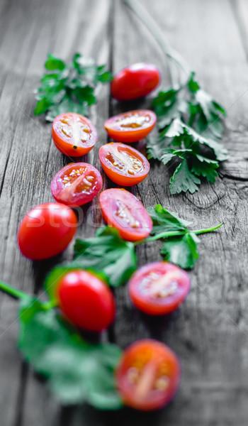 Koktélparadicsom sekély mező tábla fa asztal Stock fotó © Phantom1311