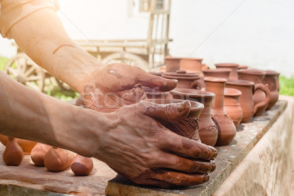 hands put crock Stock photo © Phantom1311