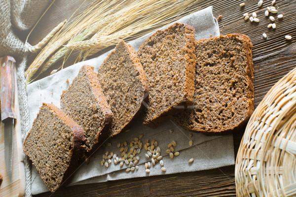 Darabok kenyér tábla sekély mező teljeskiőrlésű Stock fotó © Phantom1311