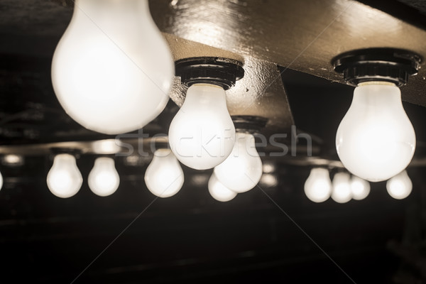 Stock photo: glowing lamp on wooden base