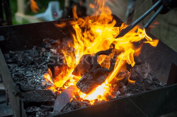 Chauffage métal main feu hommes travailleur Photo stock © Phantom1311