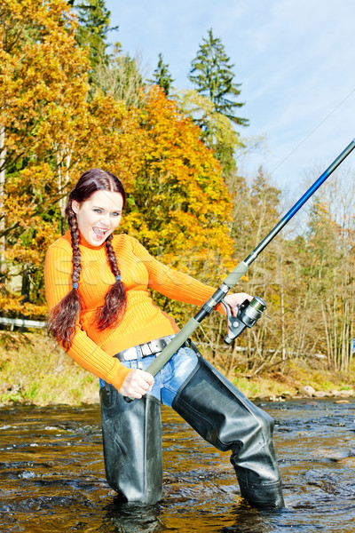 Kadın balık tutma nehir Çek Cumhuriyeti kadın sonbahar Stok fotoğraf © phbcz