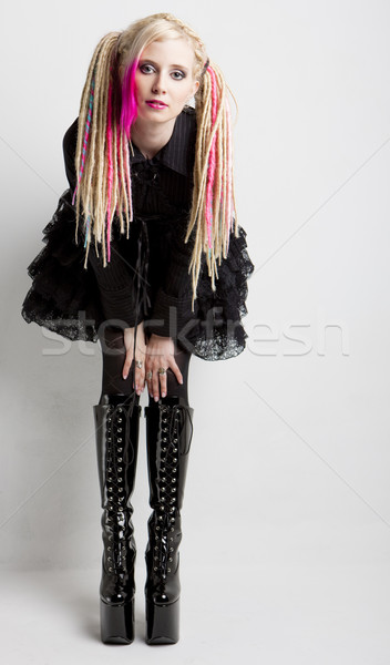 young woman with dreadlocks wearing extravagant clothes and boot Stock photo © phbcz