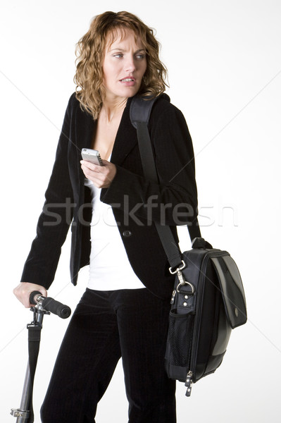 businesswoman with mobile phone and notebook Stock photo © phbcz
