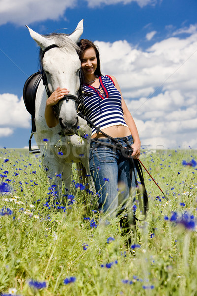 equestrian with a horse on meadow Stock photo © phbcz