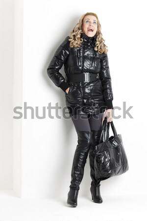 standing woman wearing extravagant clothes with handcuffs Stock photo © phbcz
