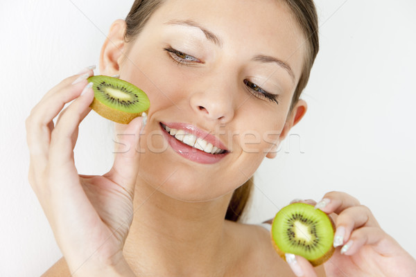 portrait of young woman with kiwi Stock photo © phbcz