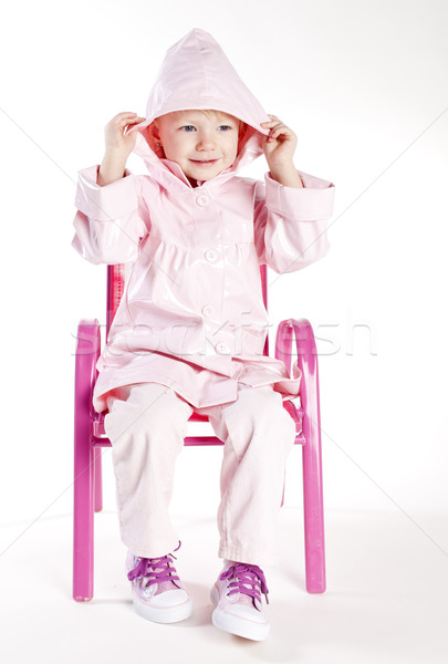 Kislány visel esőkabát ül szék lány Stock fotó © phbcz