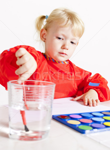 Stock photo: little girl painting with watercolors