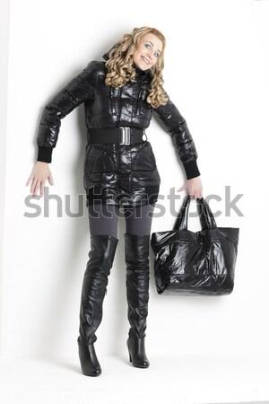ül fiatal nő visel extravagáns ruházat nő Stock fotó © phbcz