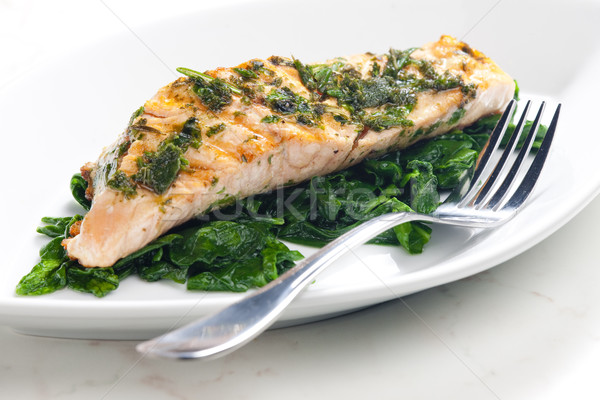 grilled salmon with herbs on fried spinach Stock photo © phbcz