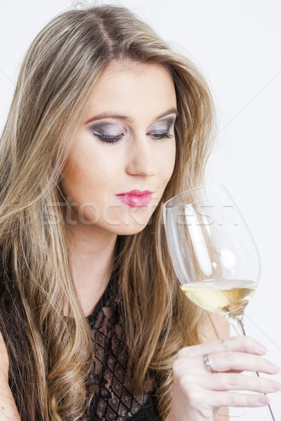 portrait of young woman with a glass of white wine Stock photo © phbcz