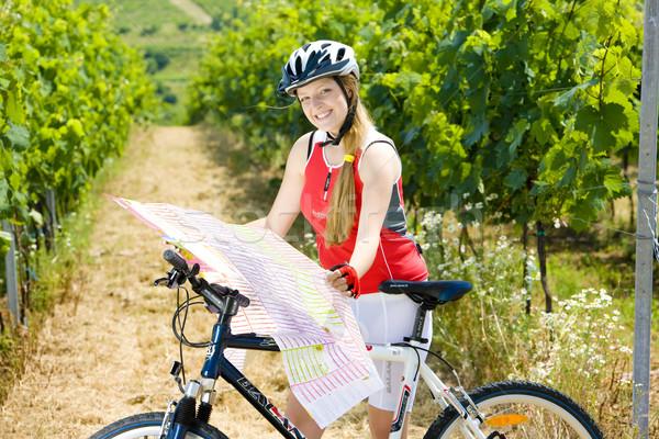 biker holding a map in vineyard, Czech Republic Stock photo © phbcz