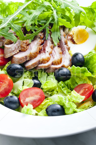 vegetable salad with fried duck breast slices and egg Stock photo © phbcz