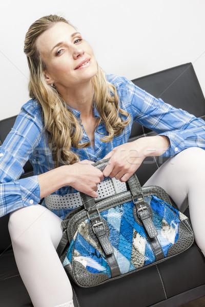 woman with a handbag sitting on sofa Stock photo © phbcz