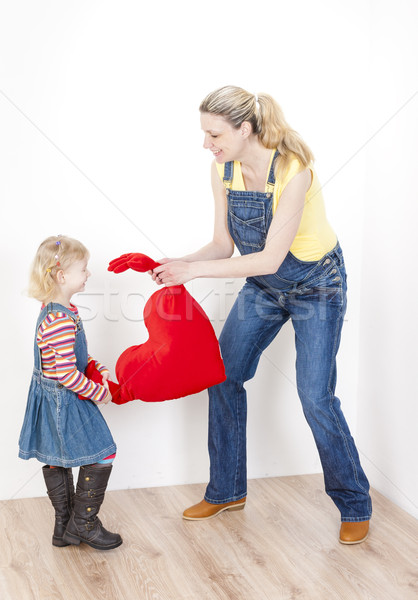little girl with her pregnant mother holding a heart Stock photo © phbcz