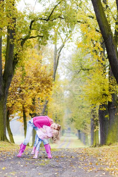 Anya lánygyermek őszi sikátor nő gyermek Stock fotó © phbcz