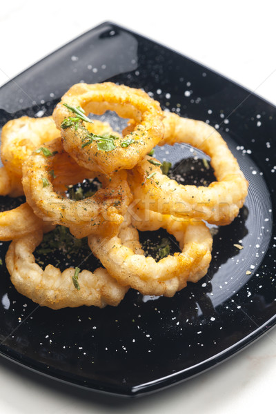 fried cuttlefish rings in batter Stock photo © phbcz