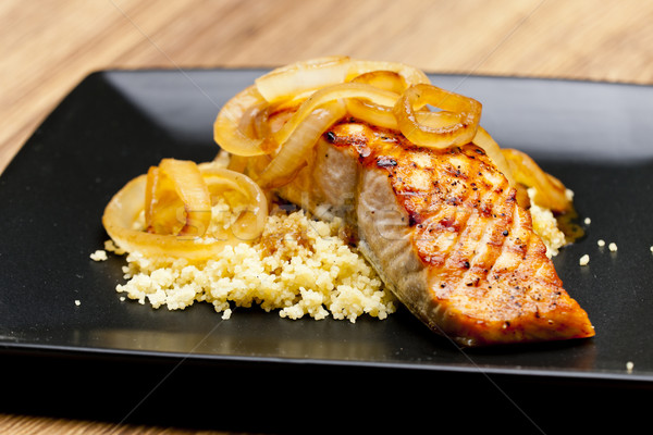 grilled salmon with burned onion and couscous Stock photo © phbcz