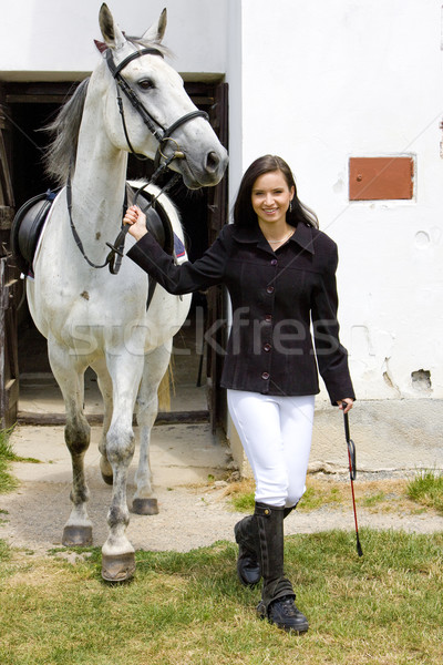 equestrian with horse at stable Stock photo © phbcz