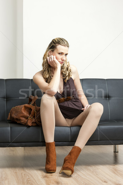 woman wearing fashionable brown shoes with a handbag sitting on  Stock photo © phbcz