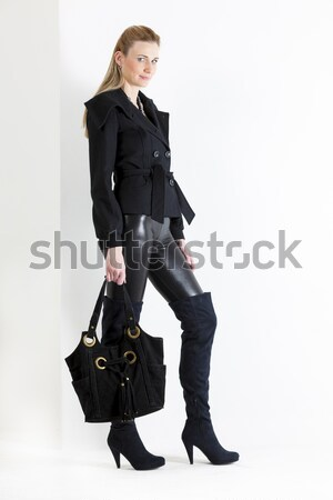 standing woman wearing black clothes with a handbag Stock photo © phbcz