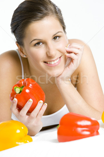 portrait of lying down woman with peppers Stock photo © phbcz